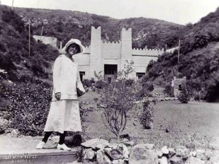 Founder and dance-lover Christine Wetherill Stevenson standing by the Pilgrimage Play Theater, now known as the Ford Theatres, in 1921.