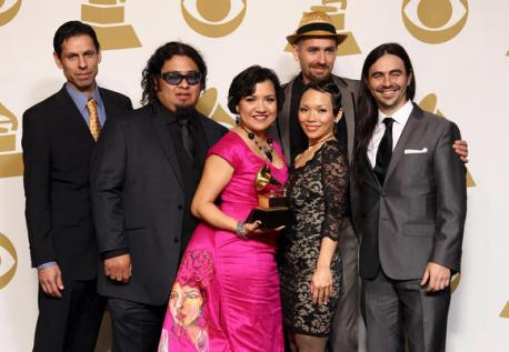 Quetzal Flores (furthest left) and the band at the 2013 Grammy Awards ceremony. (Photo courtesy of Frederick M. Brown/Getty Images)